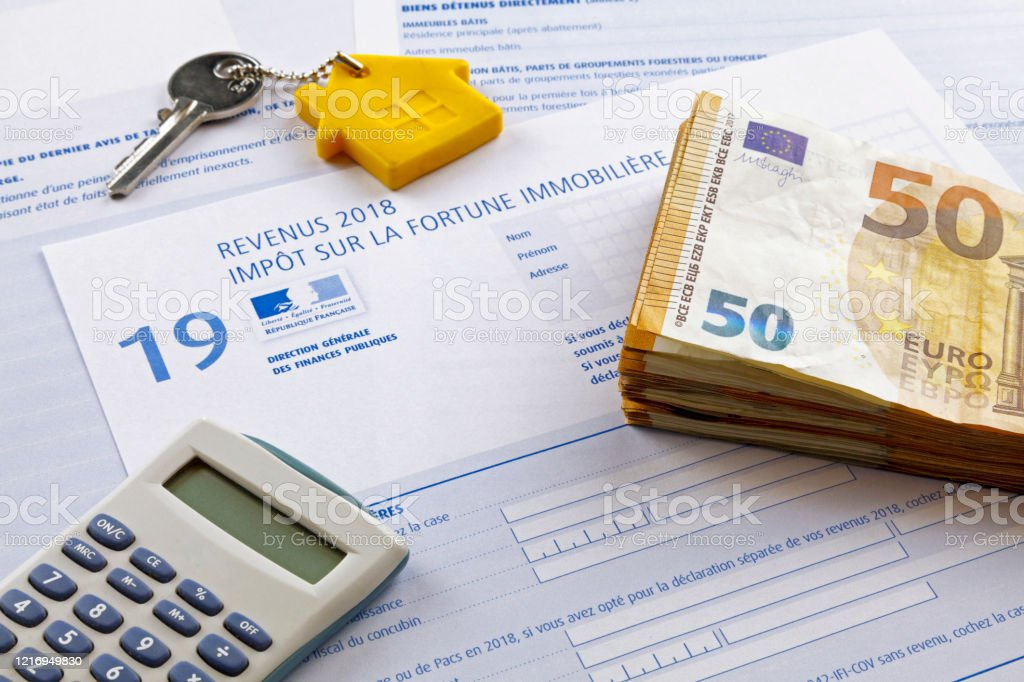 French Property wealth tax form - Royalty-free Calculator Stock Photo