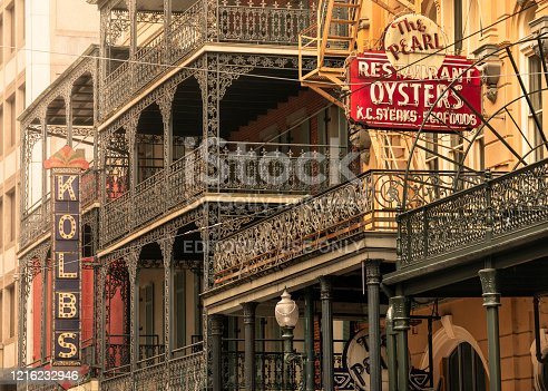 New Orleans, Louisiana - June 18, 2019:  The ornate garden terraces of houses and businesses line the historic streets of the French Quarter in New Orleans Louisiana USA
