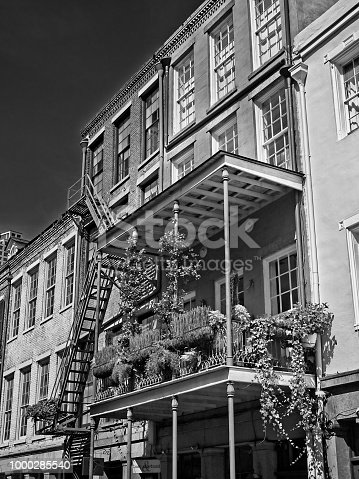 New Orleans, LA USA - May 9, 2018  -  Old French Quarter Buildings with the Flowers in B&W and Planters