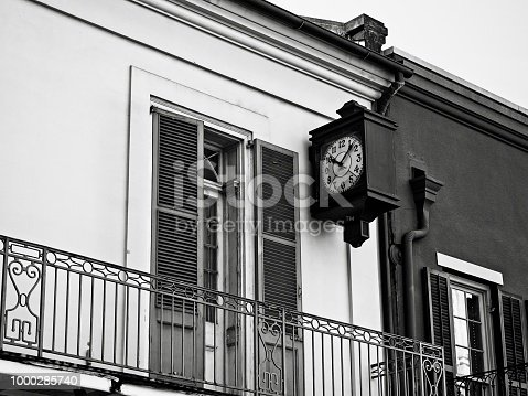 New Orleans, LA USA - May 9, 2018  -  French Quarter Building with Clock in B&W