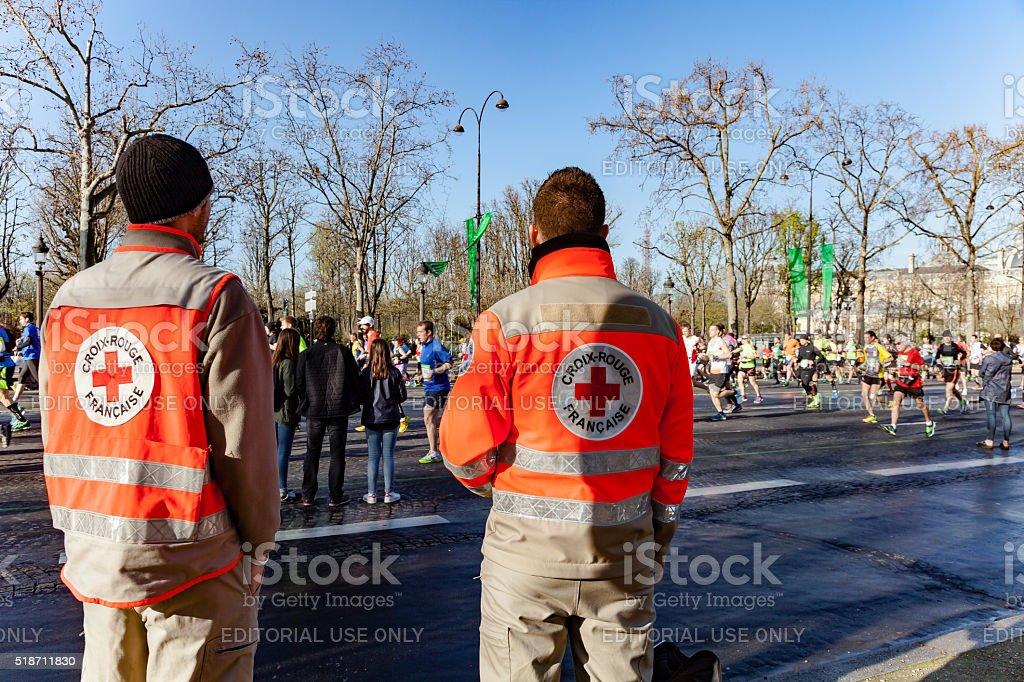 French red cross men supervising runnrers stock photo