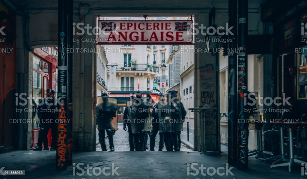 French riot police block an exit in the centre of Paris while protestors express their anger against French President Macro's government, among other issues stock photo