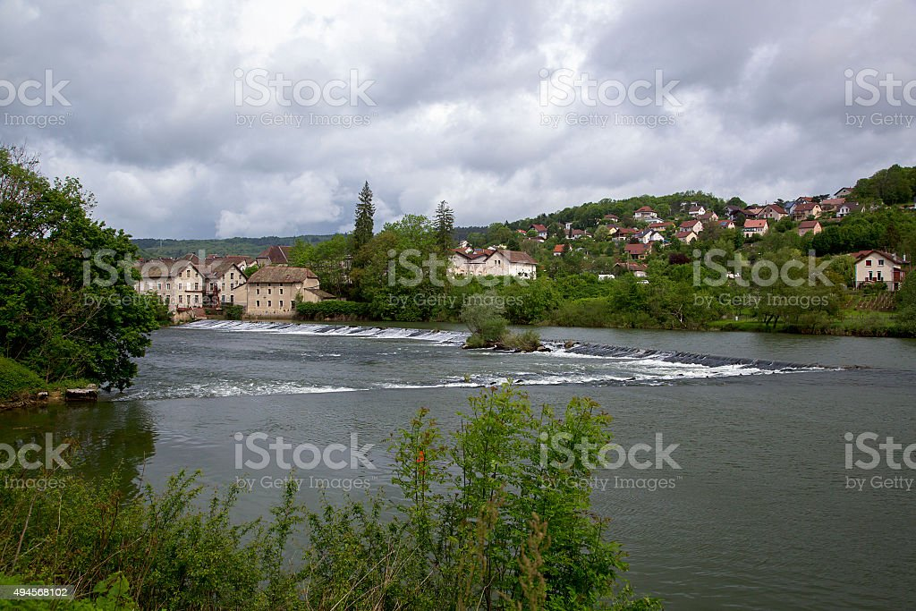 French river Doubs with city Baume les Dames stock photo