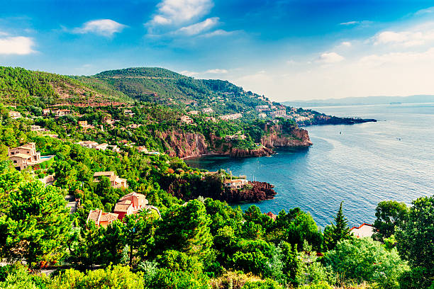 French Riviera Corniche coastline French Riviera coastline in the Var Department of Provence Cote d'Azur looking towards Pointe des Deux Freres. AdobeRGB colorspace. var stock pictures, royalty-free photos & images