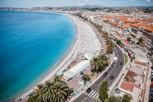 Cote d'azur in Nice Cote d'azur in Nice of France is always a good idea for family travelers or solo adventurers with its stunning Baic des Anges by the blue Mediterranean sea. côte d'ivoire stock pictures, royalty-free photos & images