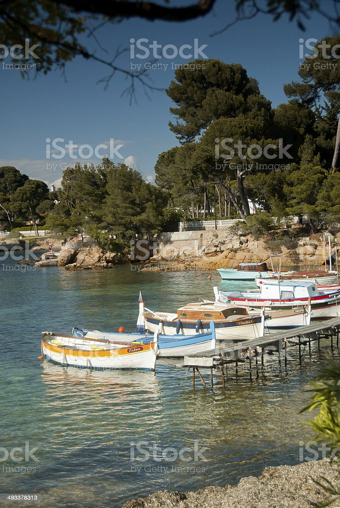 French Riviera View: Fishing boats at Cap d'Antibes stock photo