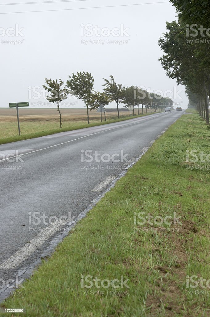 French road on wet misty morning royalty-free stock photo