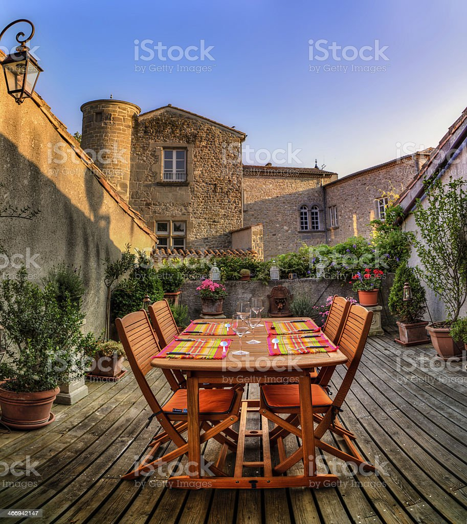 French decked Roof terrace garden dinner table