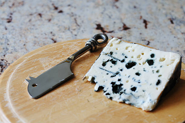 French roquefort blue cheese with mouse shaped knife stock photo