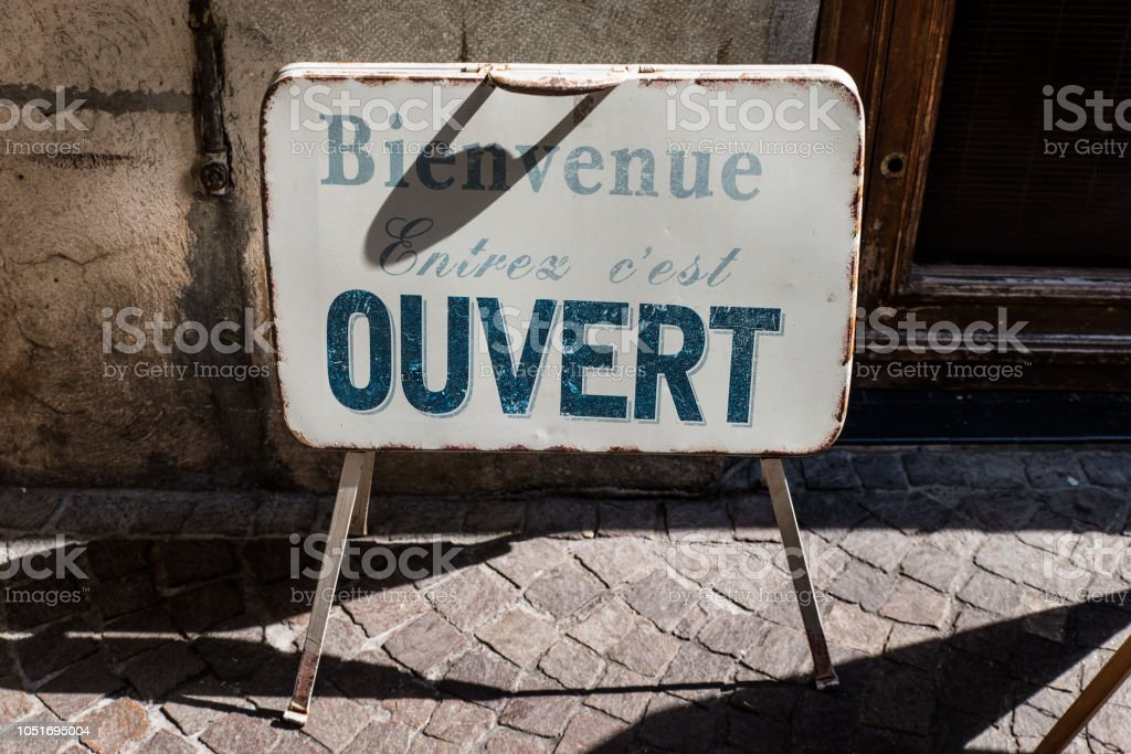 French shop sign in Annecy - Welcome. Come in, it's open stock photo