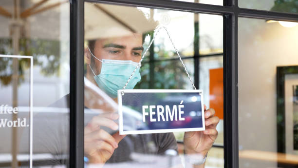 French small business closing during COVID-19 pandemic stock photo