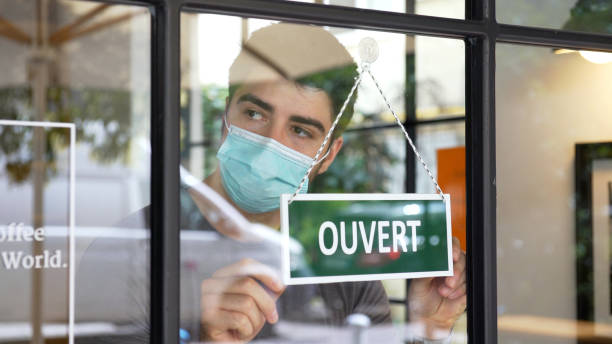 French small business opening during COVID-19 pandemic stock photo