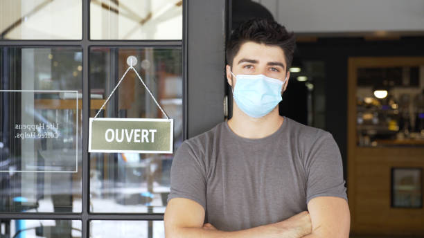French small business owner during COVID-19 pandemic stock photo