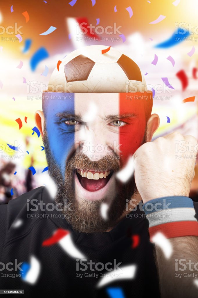 French soccer fan with football inside the head stock photo