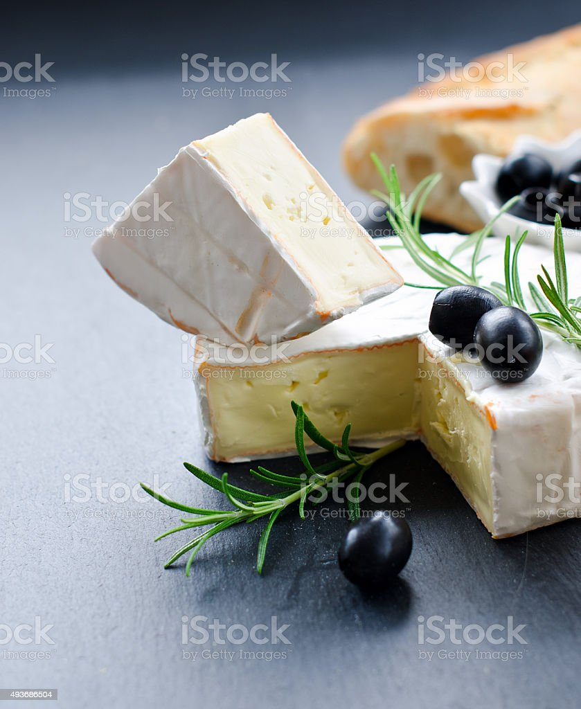 French soft cheese brie with olives and rosemary stock photo