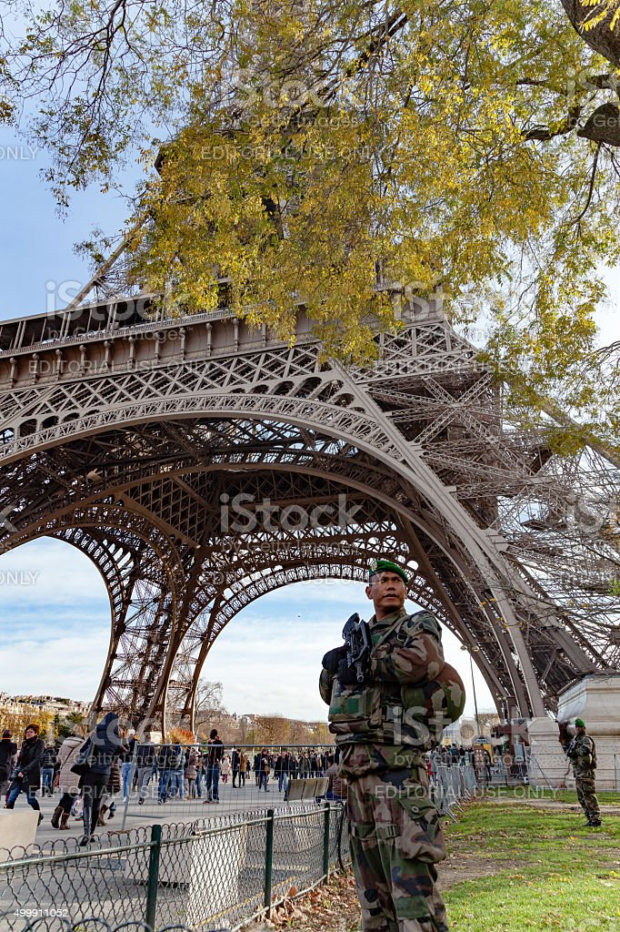 French soldier guarding the Eiffel Tower stock photo