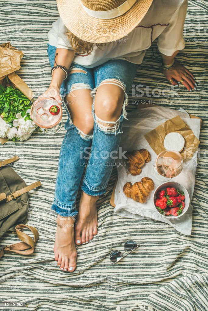 French style outdoor picnic setting with young woman in hat stock photo