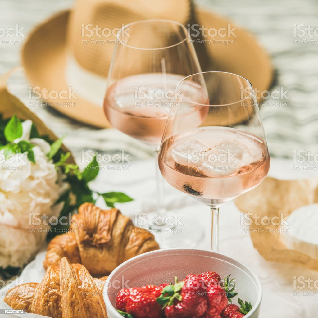 French style summer picnic setting, outdoor gathering concept, square crop stock photo