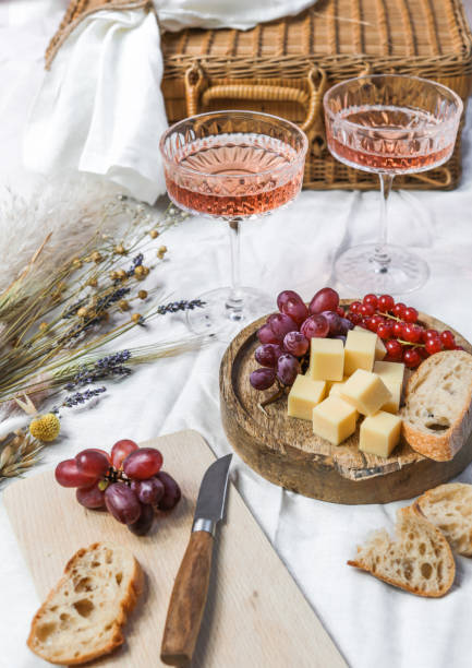 French Summer Picnic with Rose Wine and Cheese stock photo