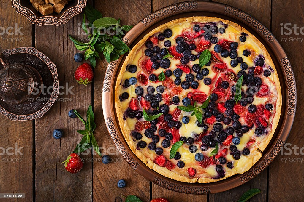French tart (flan) with berries and custard. Top view stock photo