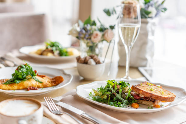 French toast brioche, Sandwich with pastrami and sun-dried tomatoes. Light morning Breakfast, fresh warm pastries on table in restaurant stock photo