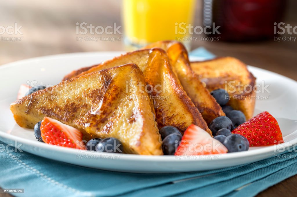 French Toast Morning Light With Syrup and Berries stock photo