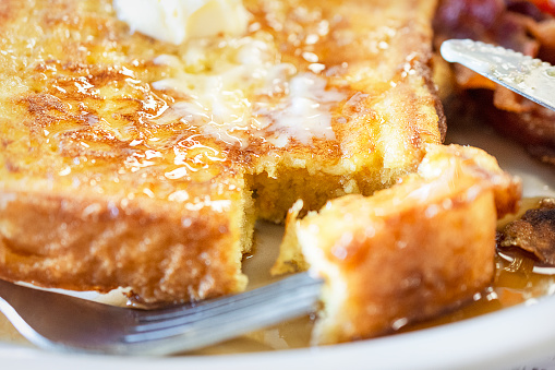 French toasts on a wooden plate, served at a restaurant