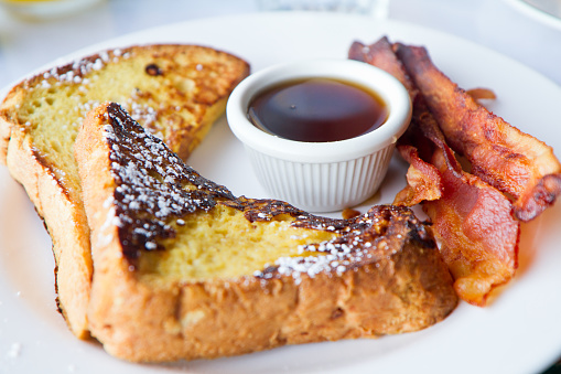 French toast sandwich with homemade omelette on dark background