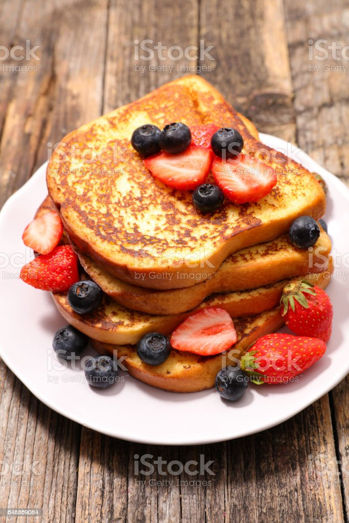 french toast with berry fruit stock photo