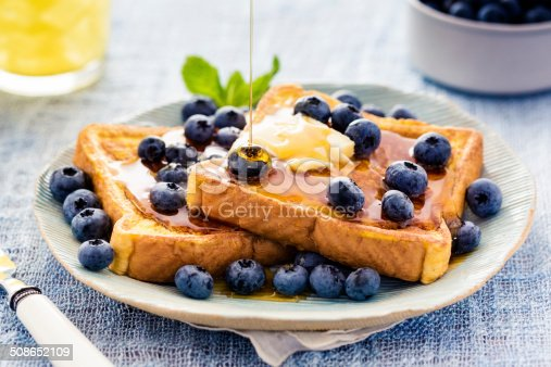 French toast flavored with blueberries, butter, mint and drizzled with maple syrup.