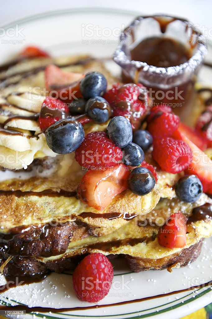 French Toast with Blueberries Raspberries Maple Syrup royalty-free stock photo