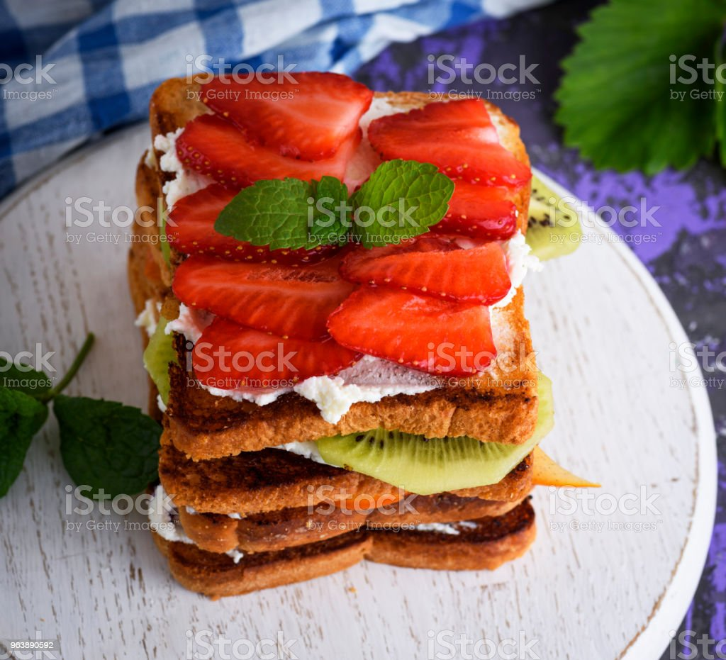 French toast with cottage cheese, strawberries, kiwi and blueberries - Royalty-free Above Stock Photo