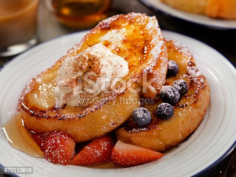 French Toast with Maple Syrup, Berries Whip Cream and Cinnamon