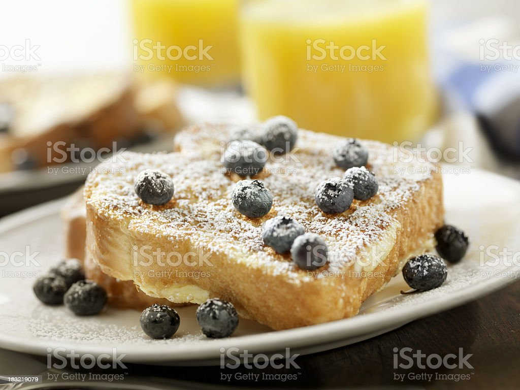 French Toast with Powdered Sugar and Blueberries royalty-free stock photo