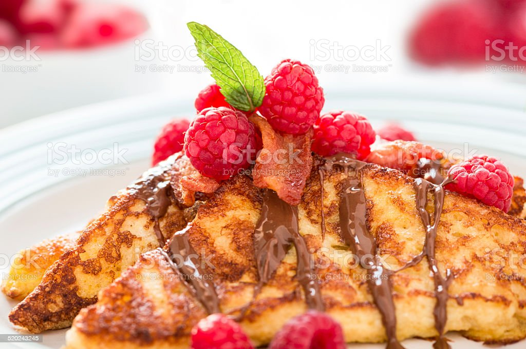 French toast with raspberries stock photo