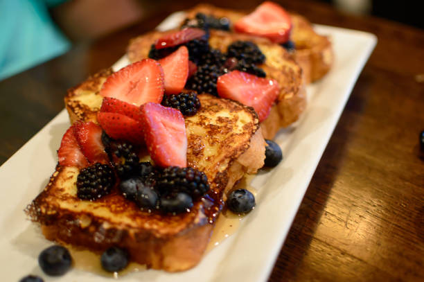 French toast with sliced berries strawberry, blackberry and blueberry stock photo