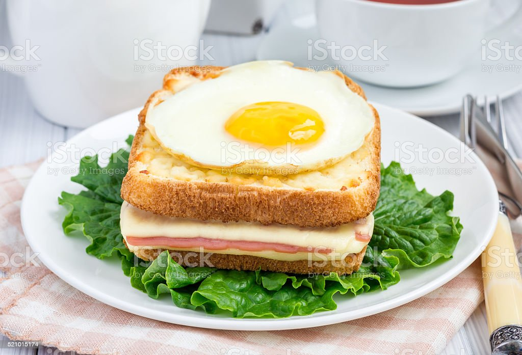 French toasted sandwich Croque madame with ham and cheese stock photo
