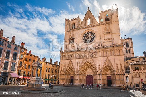 Majestic ancient architecture of Saint-Jean-Baptiste Cathedral monument in Lyon old town, in Vieux Lyon district with group of tourists. Photo taken in Lyon famous city, Unesco World Heritage Site, in Rhone department, Auvergne-Rhone-Alpes region in France, Europe during a sunny summer day.