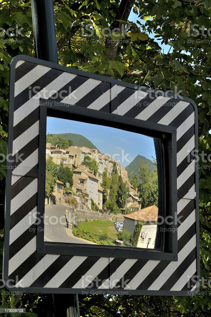French village reflected in road safety mirror royalty-free stock photo