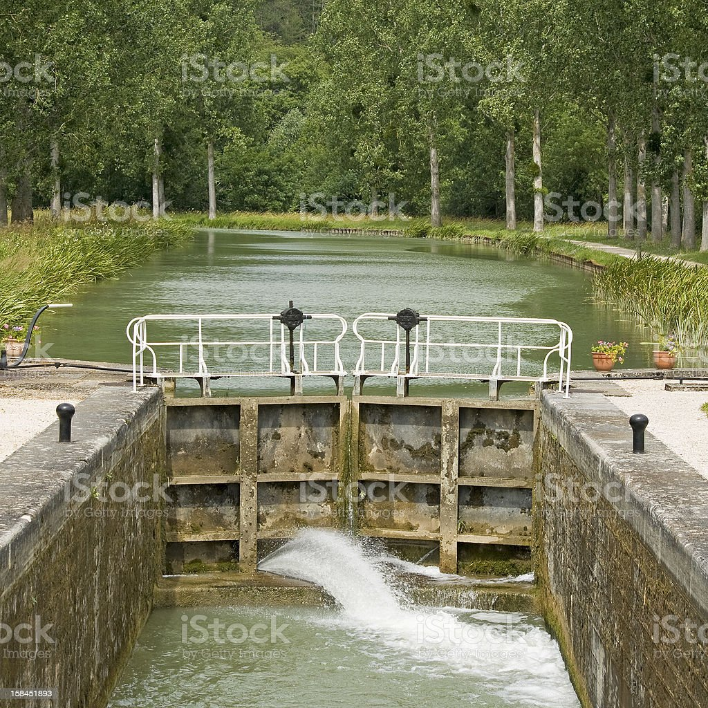 French waterway, lock in Canal Bourgogne. France. stock photo