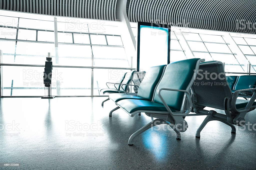 French windows of the airport terminal chairs stock photo