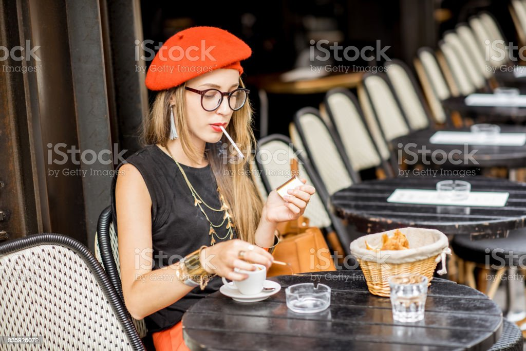 French woman smoking at the cafe stock photo