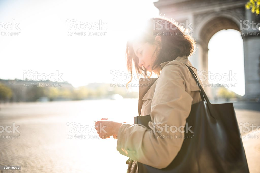 french woman waiting the bus in paris stock photo