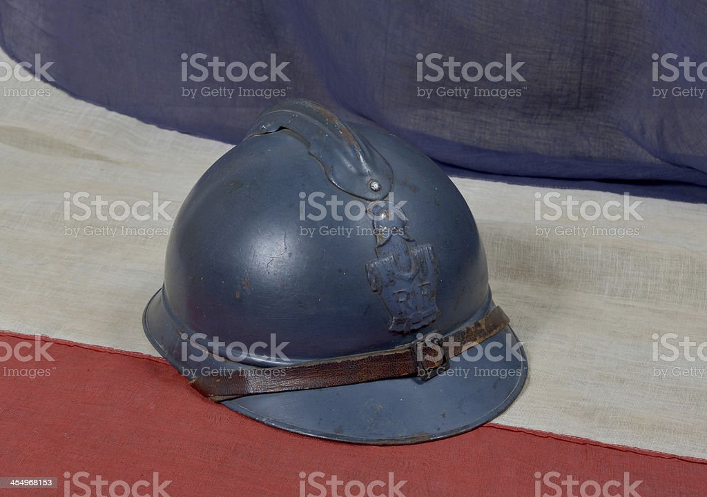 french ww1 helmet on the antique flag stock photo