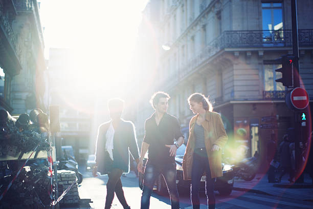 French Young People Walking on a Street stock photo