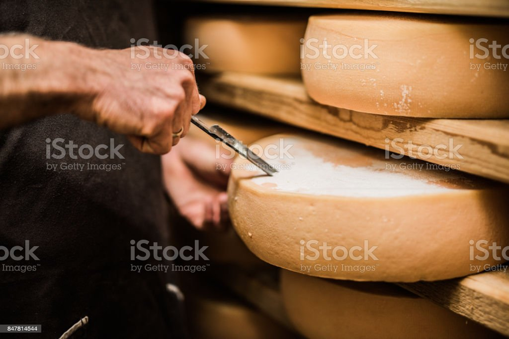 Frenchman taking a sample of premium quality cheese stock photo