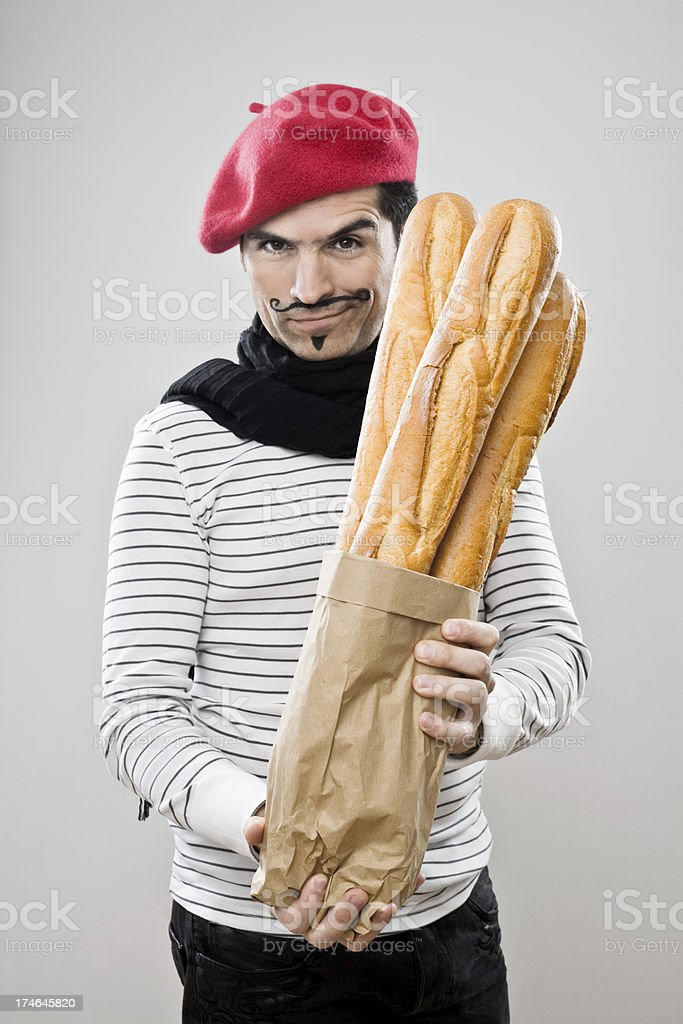 Frenchman With French Baguettes stock photo