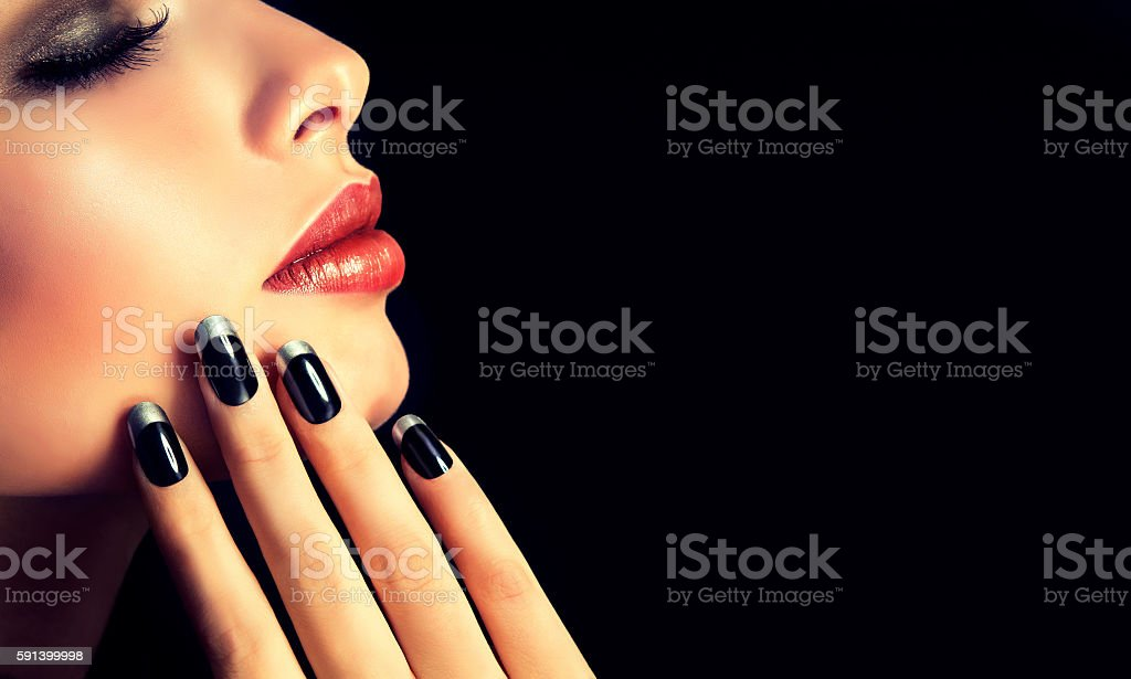 French-style manicure on nails and red lipstick. stock photo