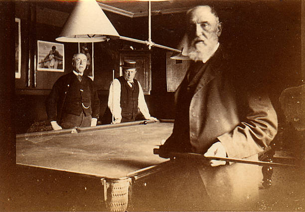 Frendly game of billiards  edwardian style stock pictures, royalty-free photos & images