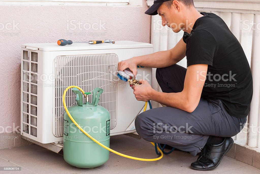 freon air conditioner refill stock photo